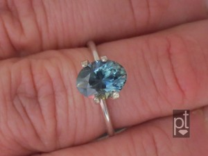 Blue-Green Sapphire in hand