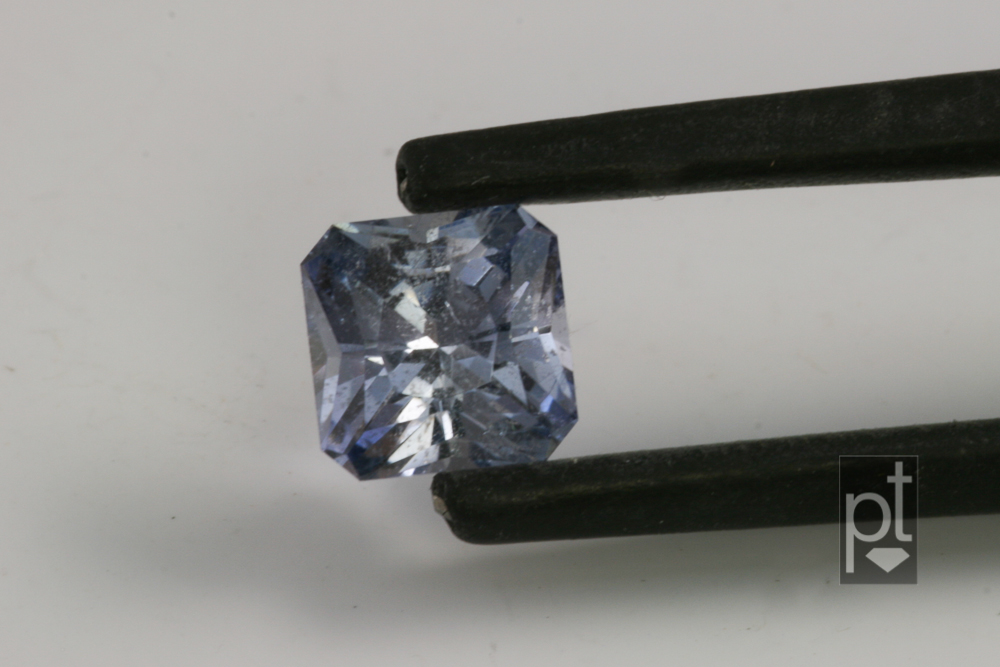 Blue Sapphire Princess Square in tweezers