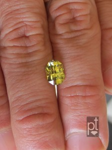 Natural Yellow Sapphire in hand