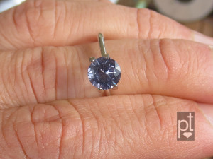 purple spinel in hand