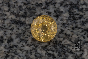 Yellow Sapphire Round with background